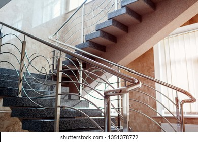 Staircase in modern buisness center building. Emergency evacuation exit. Stairs in shopping mall. White ladder by window in hotel. Urban architecture.