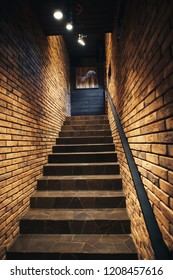 Staircase in old cellar with brick walls. Loft staircase with brick walls.
