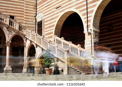 """""""Staircase of Reason"""" in courtyard the medieval """"Palazzo della Ragione"""" in Verona, Italy. Long exposure photography."""