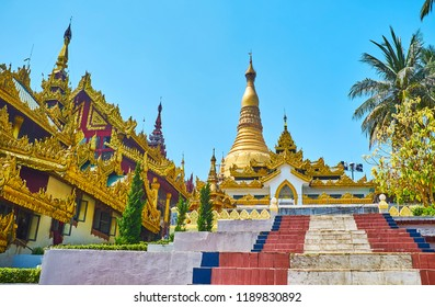 The staircase of Singuttara Hill garden is neighboring with Eastern stairway of Shwedagon Zedi Daw, covered with ornate golden roof, Yangon, Myanmar.
