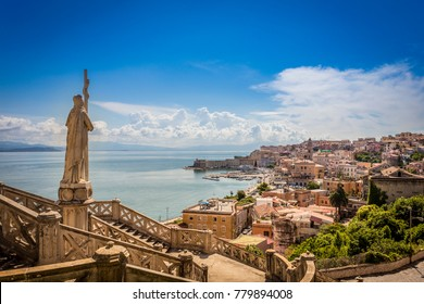 staircase with a statue of Christ with a cross, from the statue you can see the sea of the Gaeta city,Italy, the church is Saint Francis