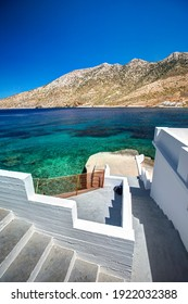 Staircase straight to the turquoise waters, in Kamares, Sifnos island, Greece