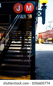 Staircase to a subway station for the J and M lines on a street in Brooklyn, New-York.