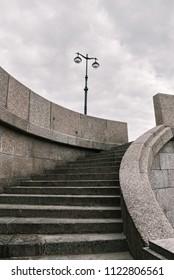 Staircase to Universitetskaya embankment of Neva river in St. Petersburg. Toned
