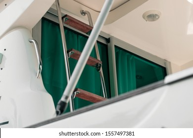 Staircase to the upper deck of the yacht. Steps on the fly bridge of a two-tier ship