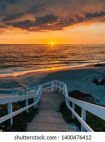 Staircase and view of the Pacific Ocean at sunset, at Windansea Beach, in La Jolla, California