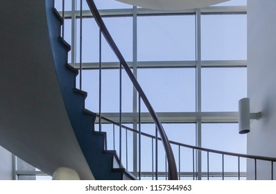 A staircase with with windows in a modern office building