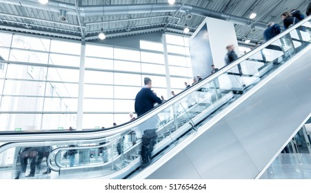 staircases at a traid fair with blurred people