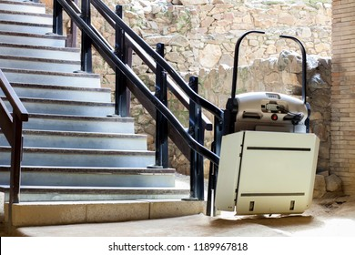 Stairlift for disabled and elderly people to climb stairs at archaeological site. Archaelogy and disability concept