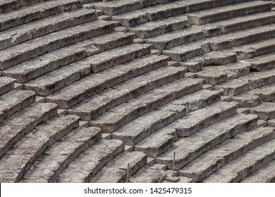 Stairs of the ancient theatre of Epidaurus in the Epidaurus town, on Peloponnesus peninsula, Greece. The theater was dedicated to the ancient Greek God of medicine, Asclepius. Stairs closeup.