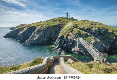 Stairs and bridge leading to Stramble Head Lighthouse on Ynys Meicel Island in Pembrokeshire,