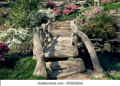 Stairs, bridge over a stream, blooming azaleas in the park Old Mill, the city of Little Rock, Arkansas, USA