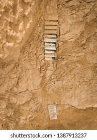 Stairs buried in the sand, desert, feeling of pessimism and hardnest, lost and broken path.