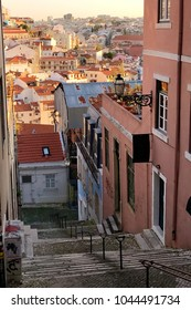 Stairs and colorful houses with street art graffiti in traditional historical Alfama district in Lisbon, Portugal, south Europe