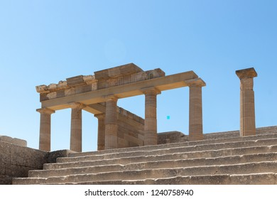 stairs and columns as ruins of the frontage of an old temple at the Acropolis of Lindos, Rhodes, Greece