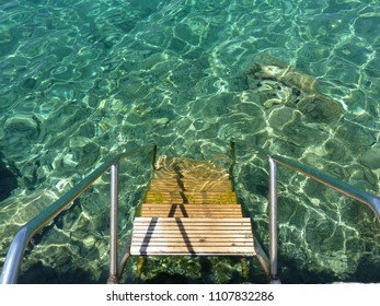 Stairs to the cristal clear waters of Adriatic Sea, island of Mljet, Croatia