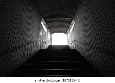 Stairs to the dark underpass, entrance to the dark underpass, view from inside.