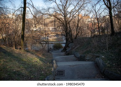 Stairs Down a Hill at Morningside Park during the Winter with Bare Trees and Rocky Terrain in Morningside Heights of New York City