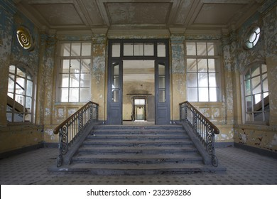stairs and entrance into old abandoned hospital, germany, beelitz