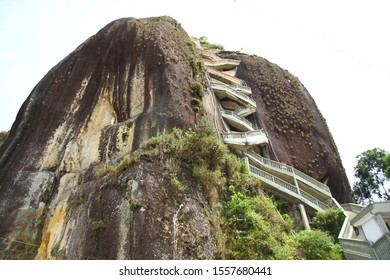 The stairs of the giant Guatape Rock (La Piedra del Penol) which has an amazing panoramic view of Penol Reservoir Lake from above, Medellin Colombia.
