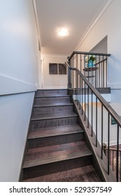 Stairs and handrail leading to the upper, low level. Interior design.