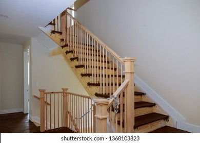Stairs handrails renovation.wizard for wooden railing for stairs Wooden planks around pole