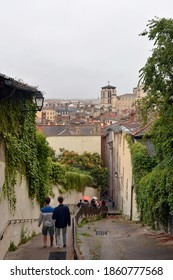 Stairs up the hill of Vieux Lyon to the Basilica Notre Dame de Fourviere and view over the roofs in Old Town of Lyon in France