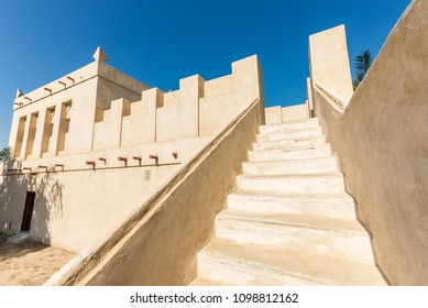 Stairs lead to the roof from the courtyard of a restored traditional arabian house.