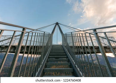"""stairs lead up to the scenic lookout of """"Il Spir"""" named after the bird """"common swift"""" above the Ruinaulta Gorge in the Surselva of Switzerland just outside Flims"""