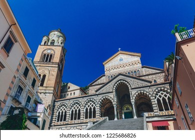 Stairs leading to the Amalfi Cathedral and bell tower under clear blue sky, in the historic centre of the town of Amalfi, on the Amalfi Coast, in southern Italy