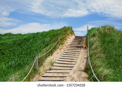 Stairs leading over the sand dunes at the beach in Greenwich, at the PEI National Park, Prince Edward Island, Canada.