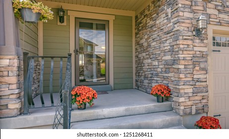 Stairs leading to porch with reflective glass door