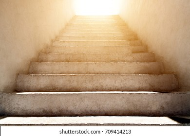 stairs leading up to the sunlight