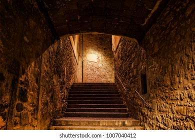 Stairs and medieval stone walls in Old Town of Girona at night, Jewish Quarter of the city, Catalonia, Spain.