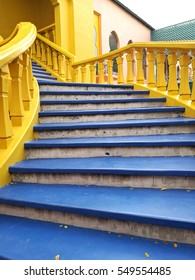Stairs  in the park . blue and yellow
