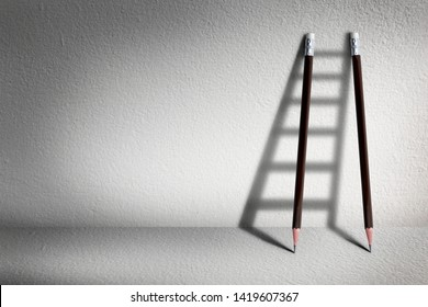 Stairs with pencil for effort and challenge in business to be achievement and successful concept.