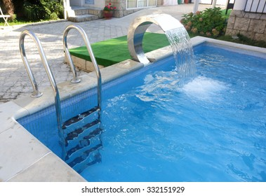 Stairs to the pool and an artificial waterfall