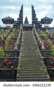 Stairs to Pura Agung Besakih temple by blue sky. Summer landscape with religious building pura basuki puseh jagat on Bali, Indonesia