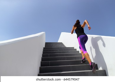 Stairs running workout woman training cardio at gym. Fitness girl exercising legs muscles outdoors with explosive exercises.