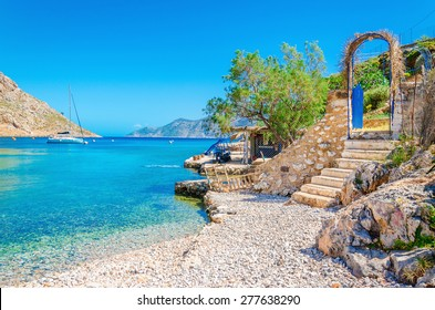 Stairs from sandy beach of amazing bay on Greece island Kalymnos, Greece