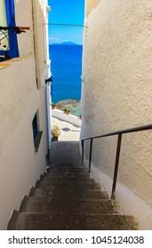 Stairs in Sant Angelo descending to the promenade along the sea, Ischia, Italy.