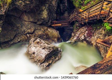 Stairs in the Seisenbergklamm gorge. Natural wonder including huge caverns, deep gorge with rapids and wood walkways.