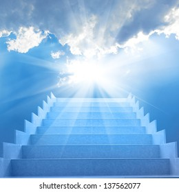Stairs in sky. Concept with staircase, sun, white clouds and blue background