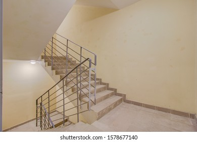 STAIRS WITH STEPS AND RANKS IN A RESIDENTIAL HOUSE. flight of stairs. Fire exit.