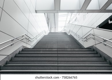 Stairs from underground upward in modern city space.
