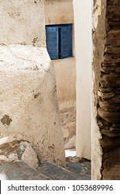 stairs in a very close corridor on a classic Cycladic old neighborhood with Cycladic architecture on the village of Ios island on Greece