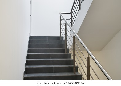 Stairs and white walls. Indoor scene.
