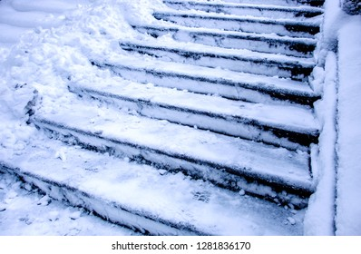 stairs in winter - covered by snow
