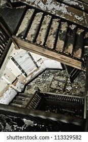 Stairway in an abandoned building, looking down the stairs.
