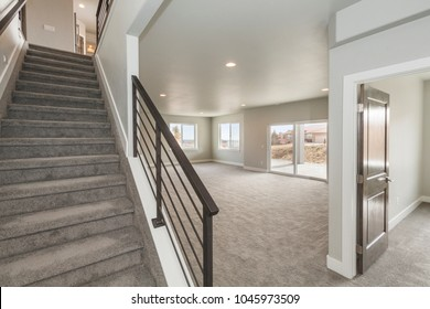 Stairway to Basement with Modern Metal Railing